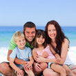 Portrait of a family at the beach - 