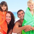 Parents with their children in towels — Stock Photo