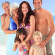 Portrait of a joyful family at the beach — Stock Photo
