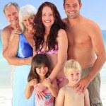 Portrait of a joyful family at the beach — Stock Photo #10852831
