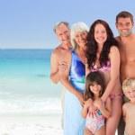 Portrait of a joyful family at the beach — Stock Photo #10852833