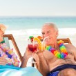 Couple drinking cocktails at the beach — Stock Photo #10852949