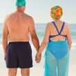 Enamored elderly couple at the beach — Stock Photo