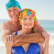 Man hugging his wife at the beach — Stock Photo