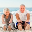 Couple doing their streches at the beach — Stock Photo