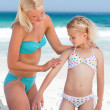 Mother applying sun cream on her daughter's back — Stock Photo #10853972