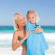 Mother with her daughter in her towel — Stock Photo #10854003