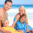 Stock Photo: Parents with their children in their towels