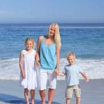 Joyful family walking on the beach — Stock Photo #10854214