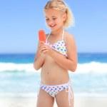 Little girl eating her ice cream — Stock Photo