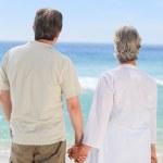 Happy couple on the beach — Stock Photo