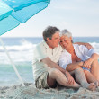 Mature couple on the beach — ストック写真