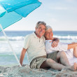 Mature couple on the beach — Stock Photo #10854636