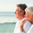 Woman hugging her husband at the beach — Stock Photo