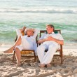 Elderly couple relaxing in their deck chairs — Stock Photo #10854855