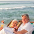 Retired couple drinking a cocktail — Stock Photo #10854905