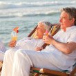 Retired couple drinking a cocktail — Stock Photo