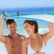 Lovers with their surfboard — Stock Photo