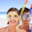 Couple with their mask at the beach — Stock Photo