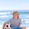 Boy with his ball on the beach — Stock Photo #10855657