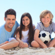 Father and his children with a ball — Stock Photo
