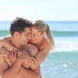 Happy lovers at the beach — Stock Photo