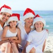 Stock Photo: Family during Christmas day at the beach