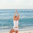Woman practicing yoga on the beach — Stock Photo #10856268