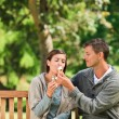Stock Photo: Couple eating an ice cream