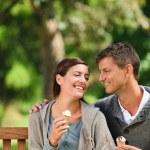 Couple eating an ice cream — Stock Photo