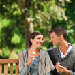 Couple eating an ice cream — Stock Photo