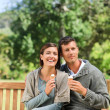 Young couple eating an ice cream — Stock Photo