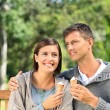 Young couple eating an ice cream — Stock Photo #10856520