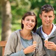 Stock Photo: Young couple eating an ice cream