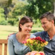 Moffering flowers to his girlfriend — Stock Photo #10856528