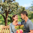 Stock Photo: Man offering flowers to his girlfriend