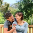 Man and his wife with a flower — Stock Photo