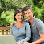 Couple working on their laptop — Stock Photo #10856577