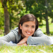 Woman lying down in the park — Stock Photo #10856604