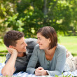Couple lying down in the park — Stock Photo #10856659