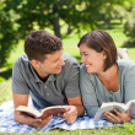 Couple reading a book — Stock Photo