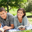 Couple reading a book — Stock Photo