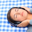 Woman listening to some music in the park — Stock Photo #10856704