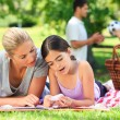 Happy family picnicking in the park — Stock Photo