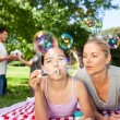 Stock Photo: Mother and daughter having fun in the park