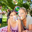 Mother and daughter having fun in the park — Stock Photo #10856794
