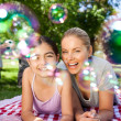 Mother and daughter having fun in the park — Stock Photo #10856796