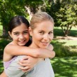 Mother and her daughter laughting in the park — Stock Photo