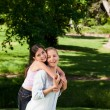 Mother having daughter piggyback — Stock Photo #10856992