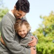 Son embracing his father — Stock Photo #10857004